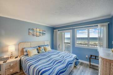 Master bedroom with private balcony and view of the Gulf of Mexico and pool