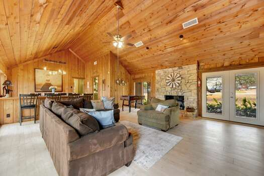 Expansive Great Room with High Ceilings, Beautiful Wood Floors, and Plenty of Natural Light