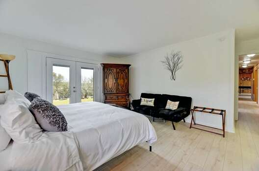 Master Bedroom with a King Bed, a Full-size Futon, a Private Bath, and Access to the Deck