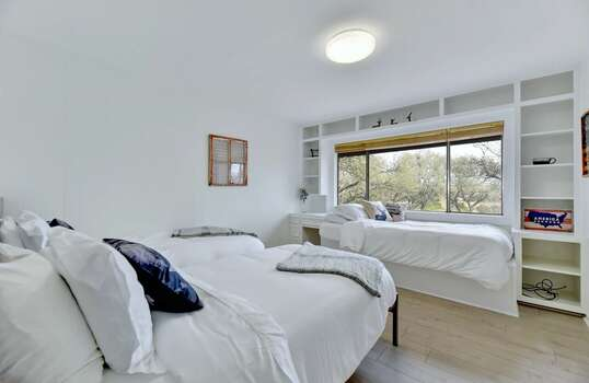 Bedroom 3 with Three Twin Beds and Views of the Rolling Hills