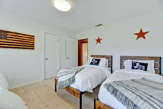 Bedroom 3 with Three Twin Beds and Access to a Full Shared Bath