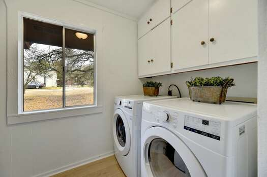Laundry Room with a Full-size Front Load Washer / Dryer