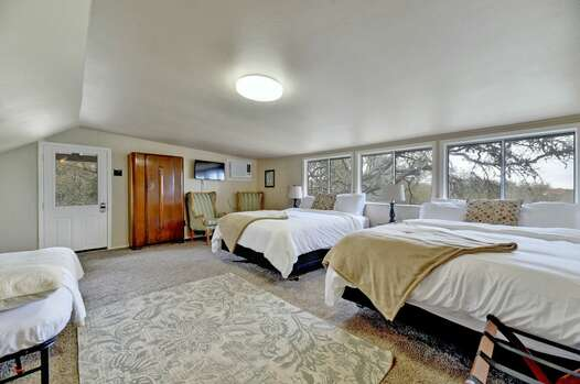 Bedroom 4 / Casita - Two Queen Beds, Smart TV, and a Wall of Windows for Plenty of Natural Light and Views of the Rolling Hills