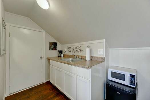 Kitchenette with a Sink, Coffee Maker, Mini Fridge, and a Microwave