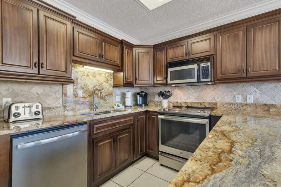 Spacious Fully Equipped Kitchen with Stainless Steel Appliances