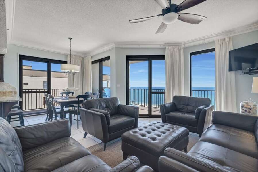 Spacious Open Plan Living Room with Plenty of Comfortable Seating, Sleeper Sofa, Flat Screen TV & DVD Player and Floor to Ceiling Views of the Gulf of Mexico