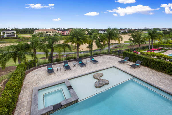 Walk outside to the balcony and take in the beautiful views of the pool and of the golf course