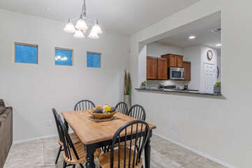Breakfast area in great room offers table seating for 6 for meals, games or puzzles.