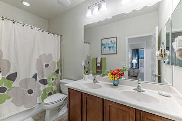 Second bathroom with dual vanity sinks and tub-shower combo is shared between Bedrooms 2, 3 and 4.