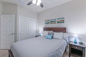 A cozy queen bed in Bedroom 4 invites quiet repose.