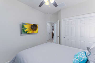 The third bedroom offers another haven for watching TV or a cat nap away from the crowd.