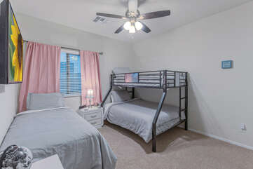 The second bedroom includes two twin size beds plus the bottom bunk is a full bed.