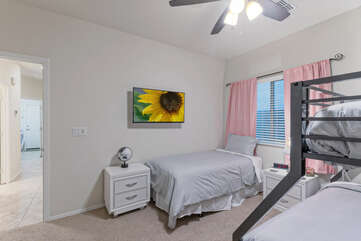 The TV in the second bedroom will keep the kids happily entertained.