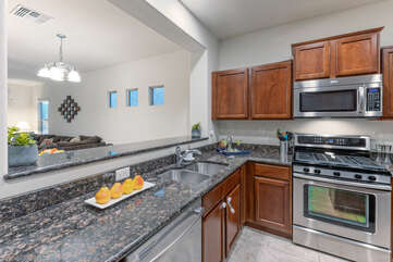 Kitchen opens into the great room for easy serving of snacks and drinks.