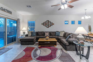 Great room offers comfortable seating for many and a view of the backyard oasis.