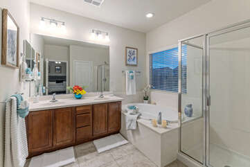 Primary bath features a garden tub, walk-in shower and dual vanity sinks.