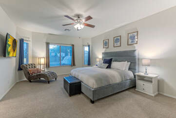 The primary suite includes a king bed, ensuite bath, ceiling fan and TV.