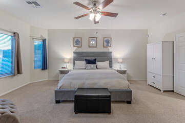 Sweet dreams in primary suite with stately king bed, armoire, lounge chair and ensuite bath.