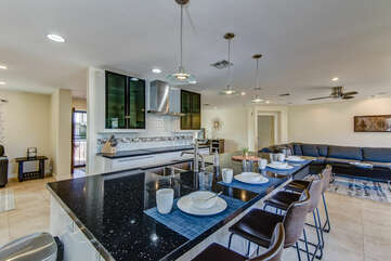Fully Equipped Gourmet Kitchen with a Large Center Island and Seating for Four