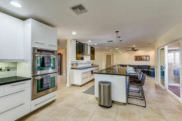 Stainless Steel Appliances Including a 4-Burner Electric Stove and Double Ovens