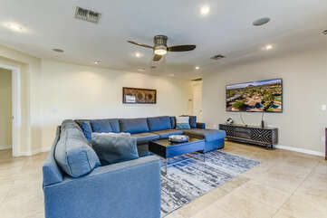 Comfortable Family Room with a 70