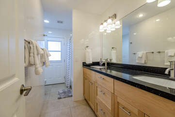 Full Shared Bath with Two Stone Counter Sinks and a Tub/Shower Combo, and Access to the Backyard