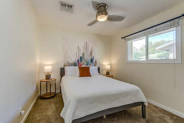 Bedroom 3 with a Queen Bed and Access to a Full Shared Bath