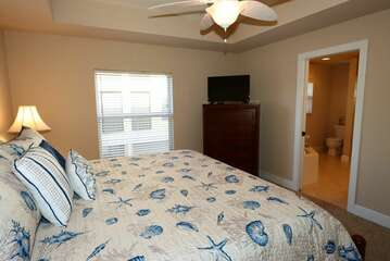 Master Bedroom with king bed and smart TV entry into master bathroom