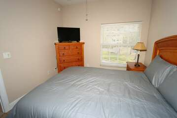 Guest Bedrrom 1 with Queen bed and TV