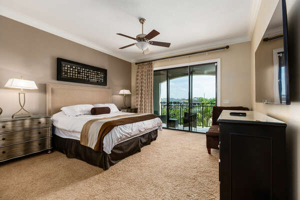 The third master suite features a king bed, 55-inch SMART TV, and access to private patio balcony