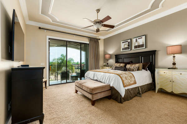 Master suite bedroom 4 features a king bed, en-suite bathroom, 55-inch SMART TV, and access to patio balcony