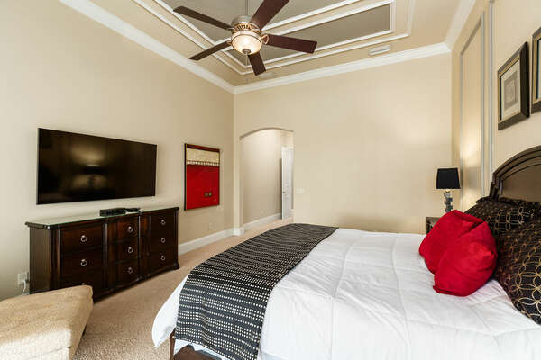 This master suite is located on the ground floor with access to the pool area