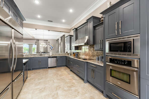 The kitchen is fully equipped and features stainless steel appliances