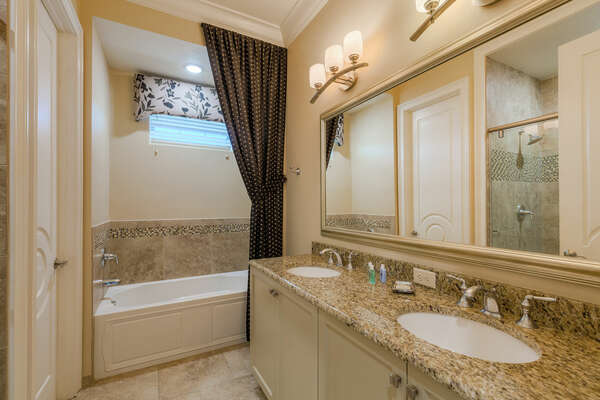 The en-suite bathroom 3 with dual vanity, bathtub, and walk-in shower