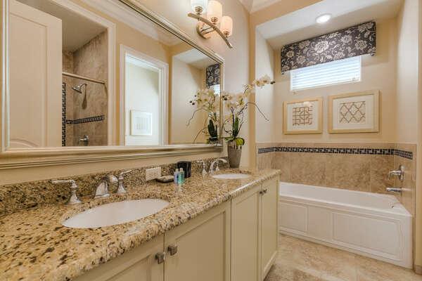 The en-suite bathroom 4 has a bathtub and glass walk-in shower