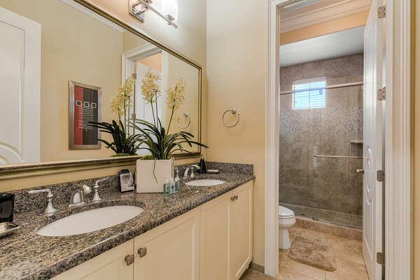 En-suite bathroom features a dual vanity and walk-in shower
