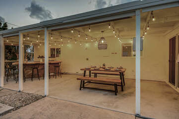 The covered dinning area will be perfect for an outdoor lunch or an evening dinner.
