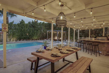 The patio dinning area is conveniently located near the barbecue and high top bar.