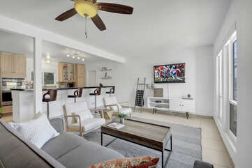 The Autry Villa opens up to a spacious living room with a gourmet kitchen.