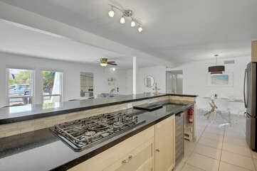 The open kitchen floor plan will allow you to mingle while getting a quick snack prepared for the kids.