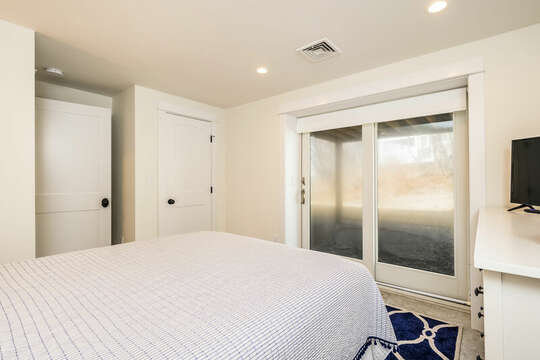 Sliders to back yard in Bedroom #5 - 74 E Bay View Road Dennis Cape Cod - New England Vacation Rentals
