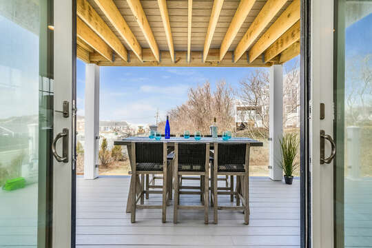 From the dining room sliders out to the deck for outdoor meals! - 74 E Bay View Road Dennis Cape Cod - New England Vacation Rentals