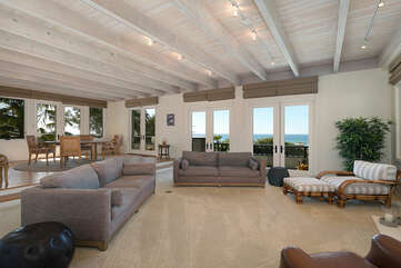 Formal living room with ocean views and plenty of seating for the whole family.