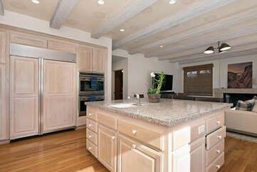 The kitchen island feature a 2nd sink and 3 barstools for social time.
