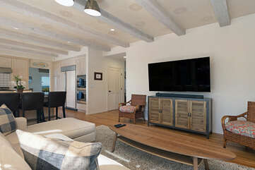 The family room opens to the outdoor seating area and allows for the ocean breeze to come inside the home.