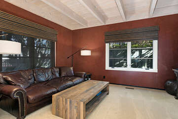 This cozy TV room is across from the formal living room and perfect for movie night. Large HD flat screen with Roku for streaming applications.