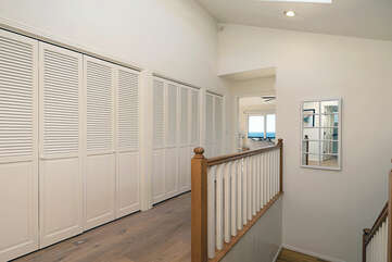 This long hallway will give you access to all 3 bedrooms upstairs.