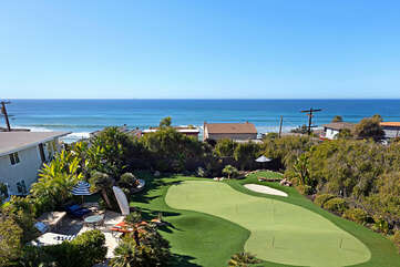 This large yard with putting greens is a rare find this close to the beach!