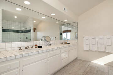 The suite feature double sinks and ocean views.