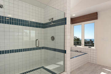 The Presidential suite features a large beautiful tiled bathroom. You will love this glass enclosed shower, soaking tub with ocean views and double sinks.